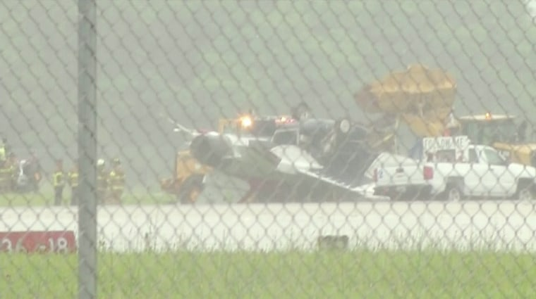 Image: A thunderbird plane is on its top at the Dayton International Airport