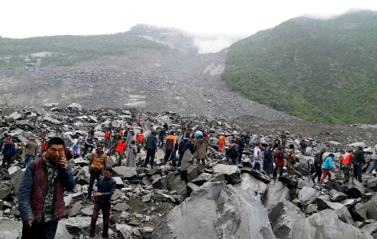 Image: Rescuers at the site of the early morning disaster in Maoxian county, China's Sichuan province.