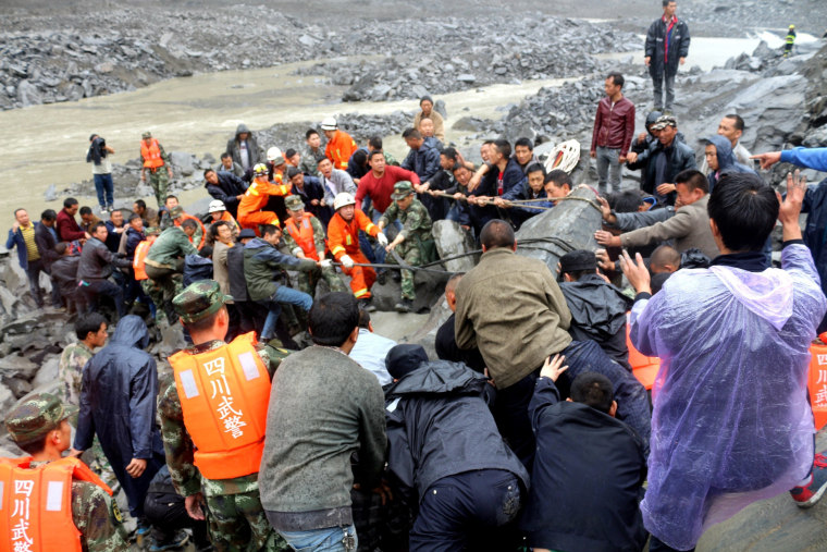 Image: Massive landslide buries over 120 in Sichuan Province, southwest China