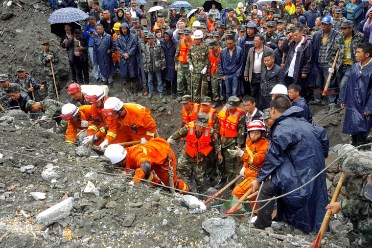 Image: Rescue workers search for survivors on June 24.