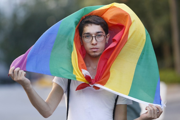 Image:  A participant walks with the rainbow flag during the LGTB Pride Parade which was cancelled in Istanbul