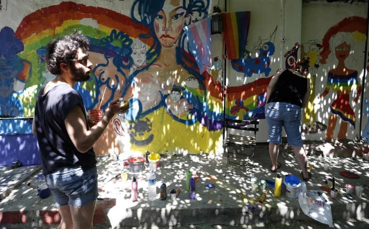 Image: People paint walls with the colors of the rainbow during LGBT Pride Week in Istanbul