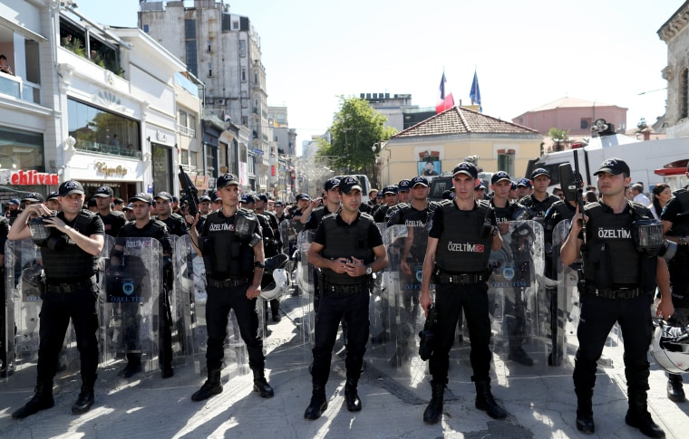 Image: Turkish police stand guard near Taksim Square during the LGTB Pride Parade which was cancelled in Istanbul