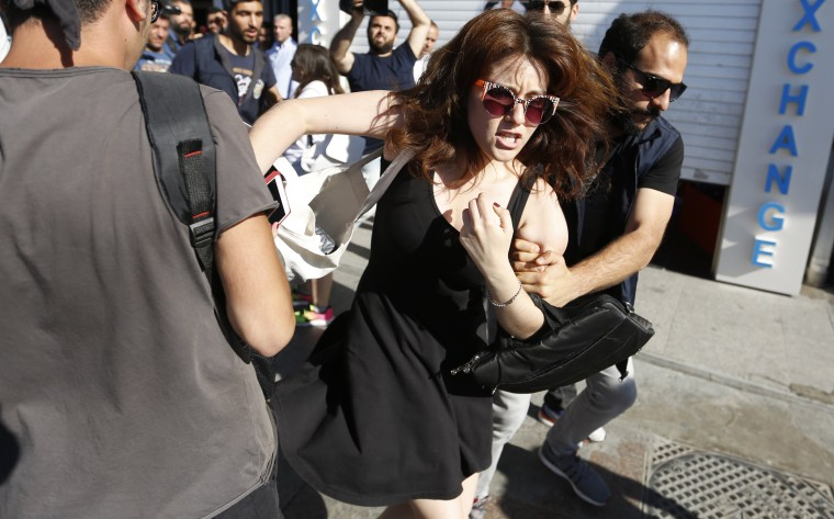 Image: Police arrest a participant during the LGTB Pride Parade which was cancelled in Istanbul