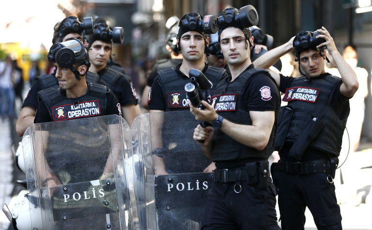 Image: Police stand guard near Taksim Square during the LGTB Pride Parade which was cancelled in Istanbul,