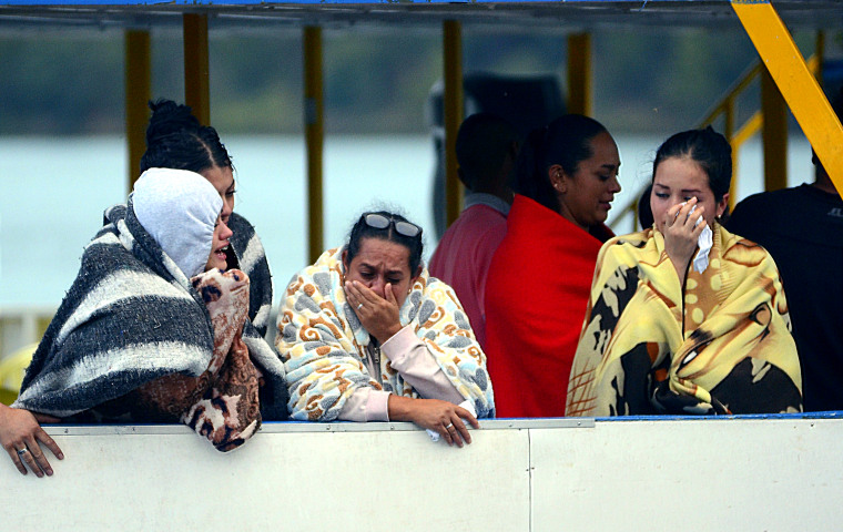 IMAGE: Onlookers wait for information in Colombia