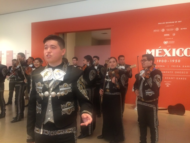 Attendees of the NALEO conference were welcomed to an exhibit of Mexican art by a mariachi band.