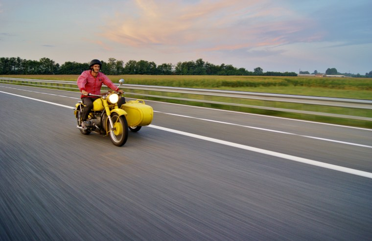"""Leon Logothetis traveled in a yellow motorbike in """"The Kindness Diaries"""""""