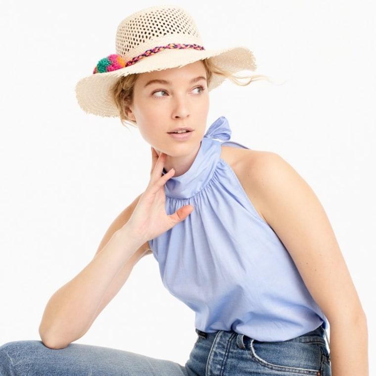 Straw hat with rainbow pom-poms