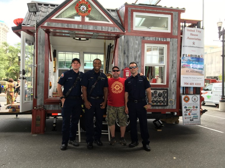 Tiny home builder John Kernohan holds a fire safety event with members from Jacksonville Fire and Rescue, Engine No. 9 in FL.