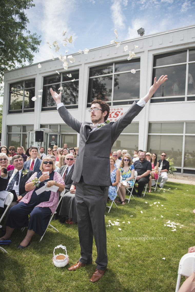 Man tosses rose petals as flower man at his cousin's wedding