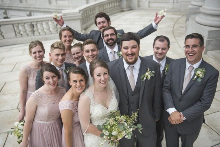 Twenty-eight year old man tosses rose petals as flower man at cousin's wedding