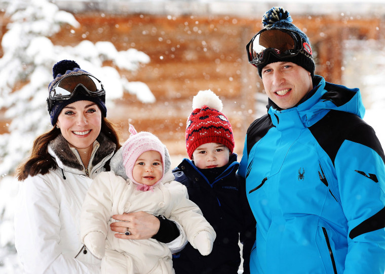 rince William and Kate, Duchess of Cambridge, with their children in the snow