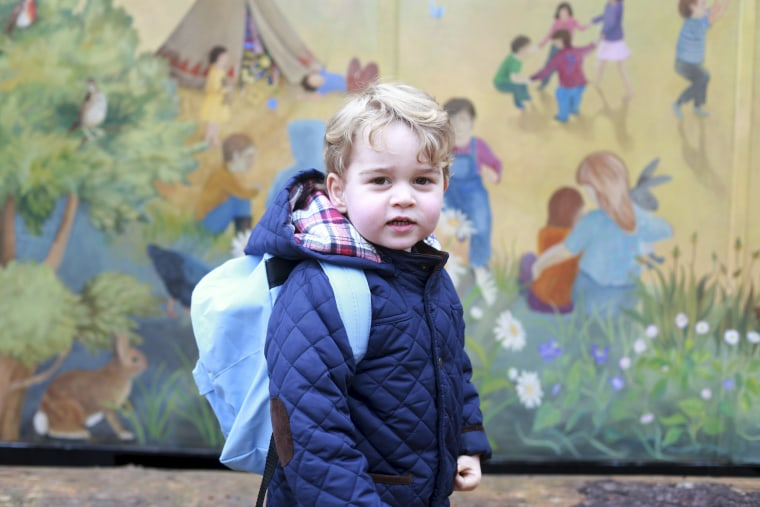 Image: Britain's Prince George stands outside the Westacre Montessori School nursery in King's Lynn