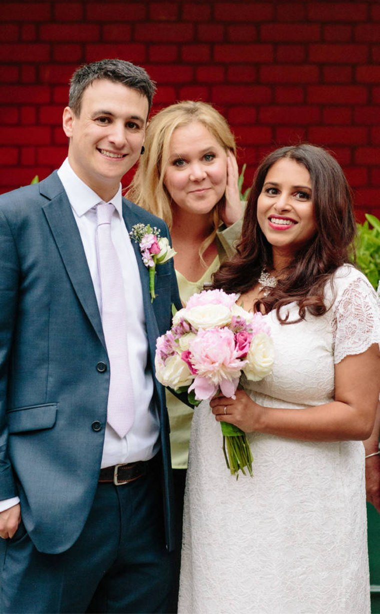 Jasmin Pereira and Jon Bates didn't mind when comedian Amy Schumer photo-bombed their wedding photo shoot in London.