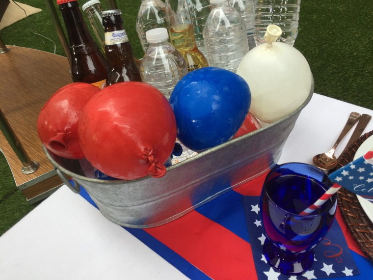 Double duty: Water ballons can cool your drink and be used for games later