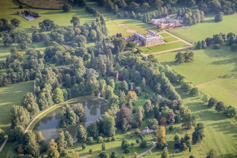 Princess Diana was interred on the grounds of her family's estate, Althorp House. The island in the Round Oval lake is her burial site.