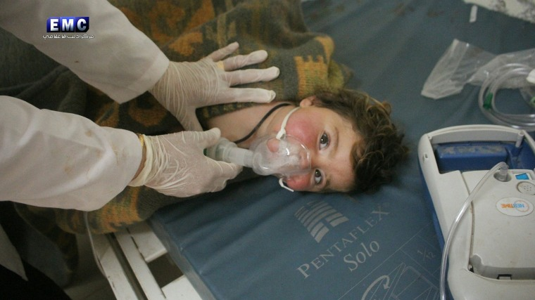 Image: A child receives treatment at a field hospital after an alleged chemical attack in Idlib, northen Syria