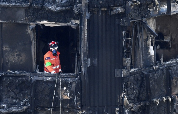 Image: A search and rescue worker inside Grenfell Tower