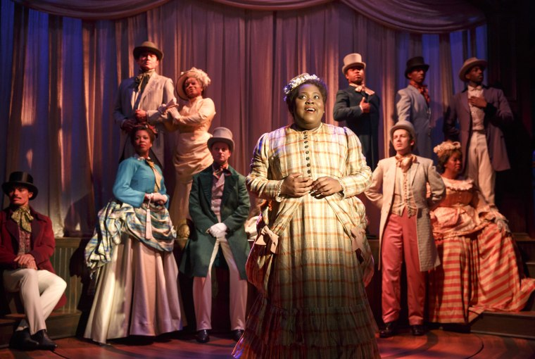 Image: Ashley D. Kelley (as Bella) with members of The Company, Bella: An American Tall Tale