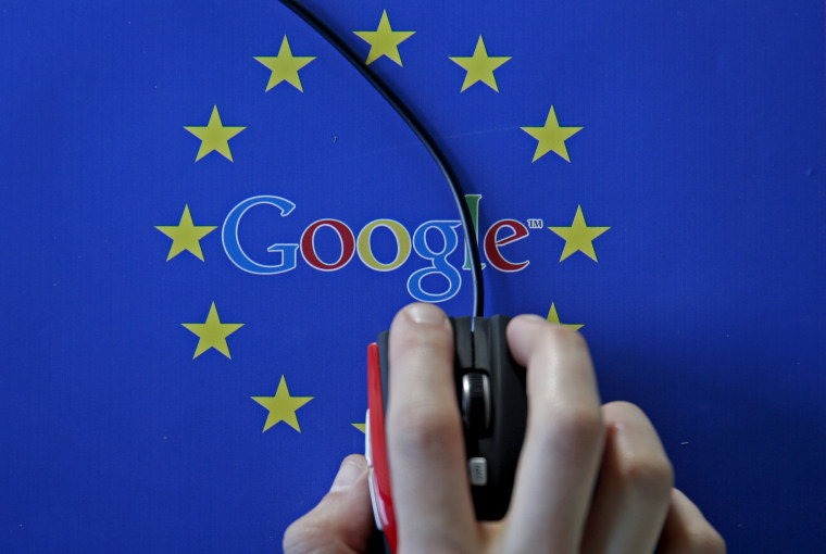 Image: A woman hovers a mouse over the Google and European Union logos