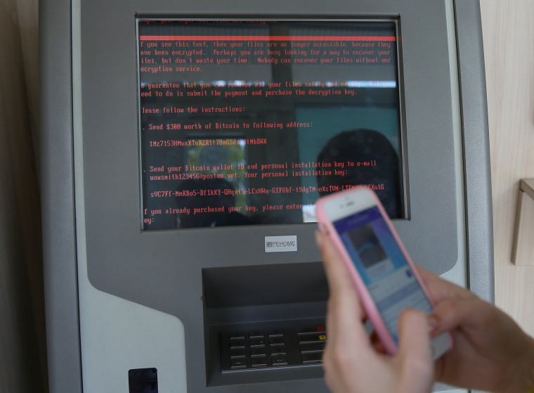 Image: A message demanding money is seen on a monitor of a payment terminal at a branch of Ukraine's state-owned bank Oschadbank after Ukrainian institutions were hit by a wave of cyber attacks earlier in the day, in Kiev