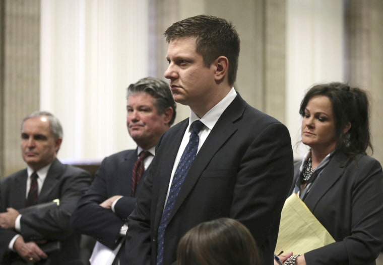 Image: Chicago police Officer Jason Van Dyke attends a status hearing