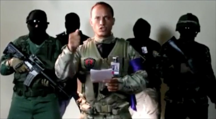 Image: Investigative police pilot Oscar Perez reads a statement from an undisclosed location