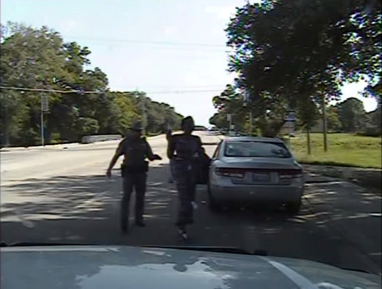 Image: Texas state trooper Brian Encinia pointing a Taser as he orders Sandra Bland out of her vehicle in Prairie View