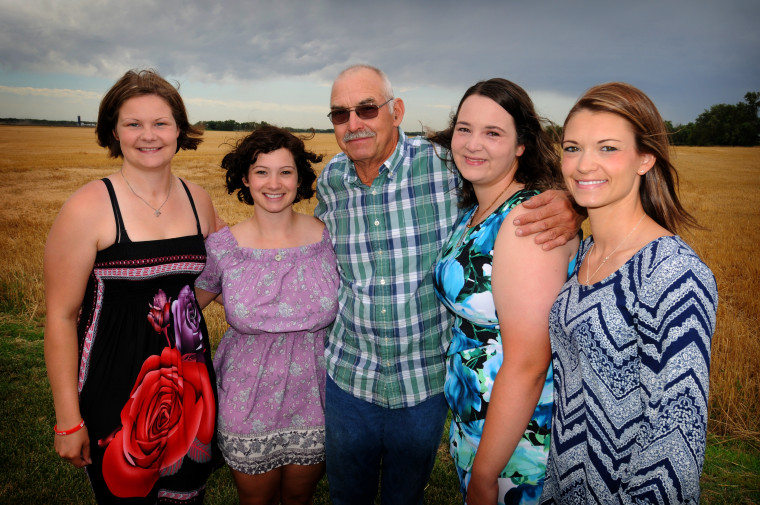 Ron Heimer (center) with his daughters Katie Eberle (left), Genell Heimer, Lynnsey Heimer, and Joni Alexander. [TOM DORSEY / SALINA JOURNAL]