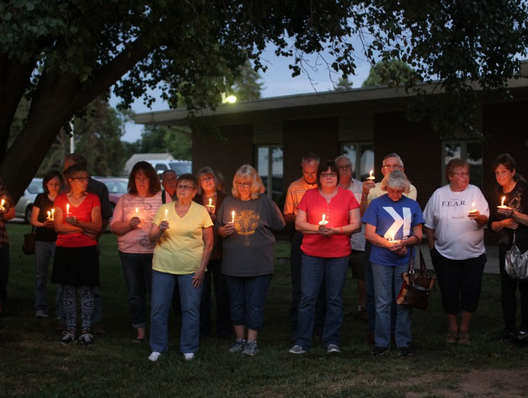 Members of the community at the one-year anniversary candlelight vigil.