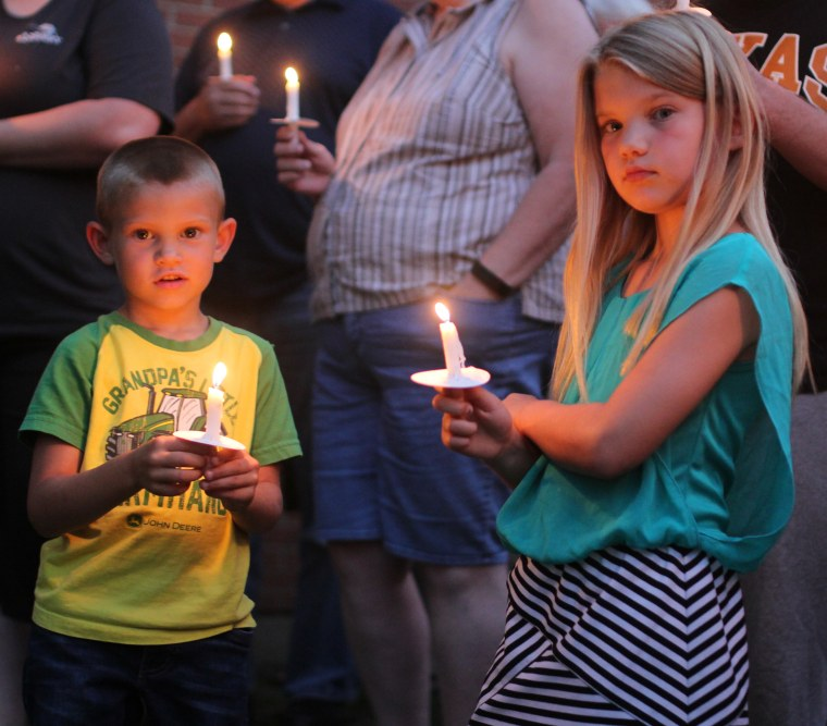 Two of Lori's grandchildren at the one-year anniversary candlelight vigil.
