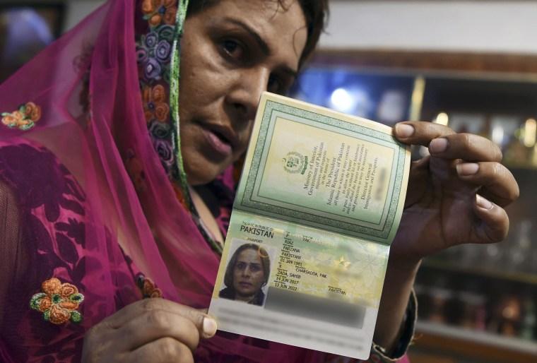 Image: Pakistani transgender Farzana Riaz displays her newly-obtained passport in Peshawar on June 28, 2017.