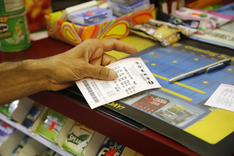 Image: A customer buys a Powerball ticket in Chicago
