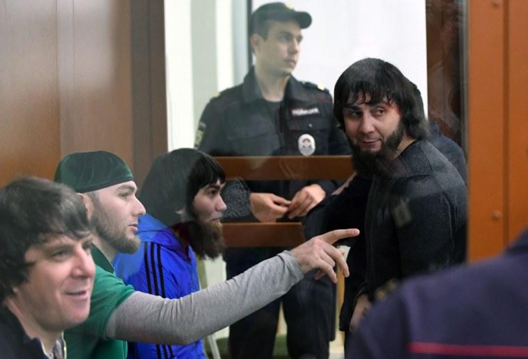 Image: Temirlan Eskerkhanov, from left, Shadid Gubashev, Anzor Gubashev and Zaur Dadayev sit during a hearing in Moscow