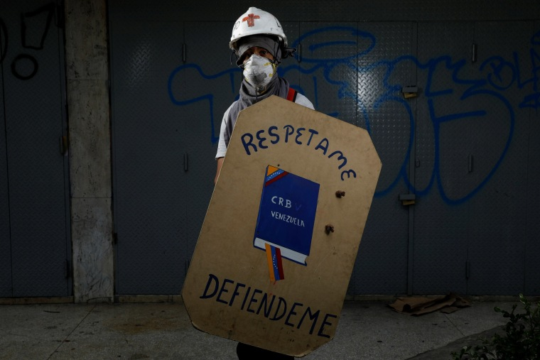 Image: The Wider Image: Venezuela's shield-bearing protesters