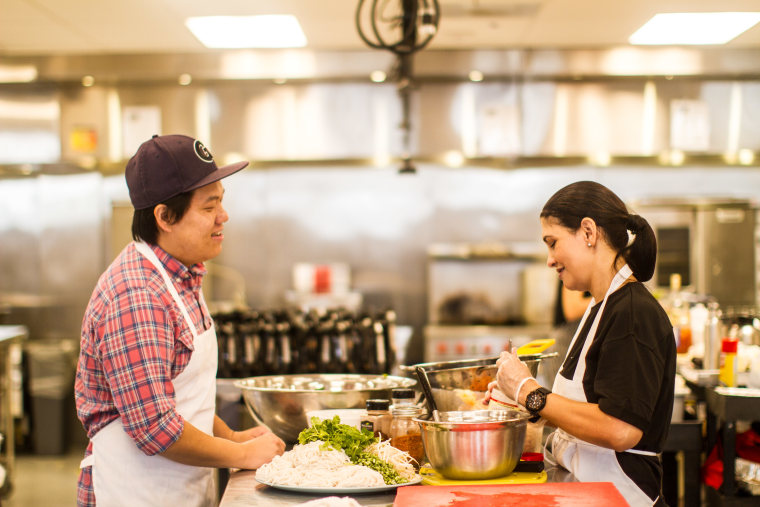 Foodhini founder Noobstaa Philip Vang with chef Melissa Frabotta at the Union Kitchen space in Washington, D.C.