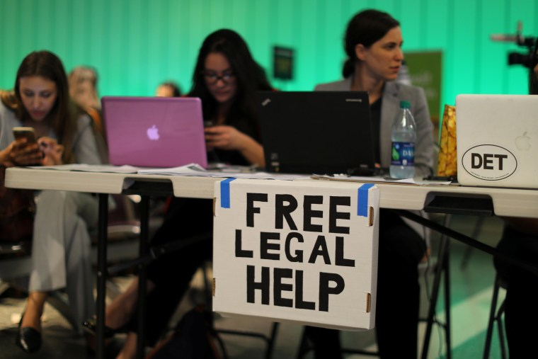 Image: Volunteer lawyers at LAX after reinstatment of U.S. President Donald Trump's travel ban