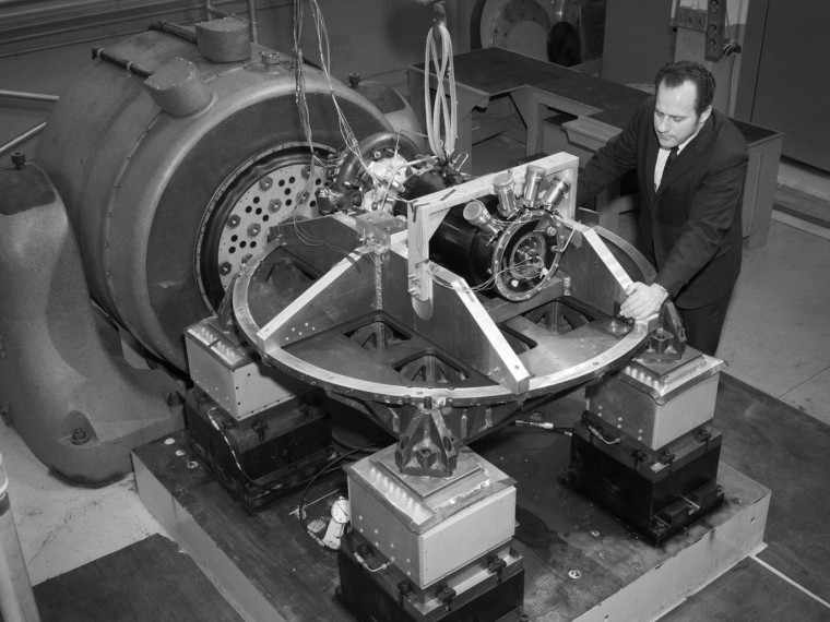 A photograph of the SNAP-8 generator from the Lewis Research Center, part of NASA's Systems for Nuclear Auxiliary Power (SNAP) program. Here, engineers exposed the system to shocks and vibrations expected to occur during a launch into space and subsequent maneuvering.