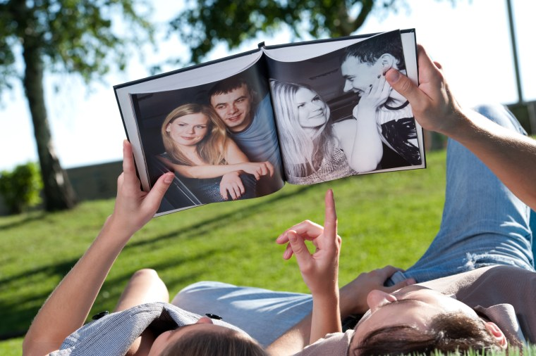 Image: Couple Look at Photo book
