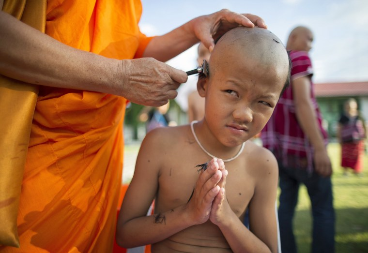 Image: Hill tribe men mass Buddhist monks ordination ceremony