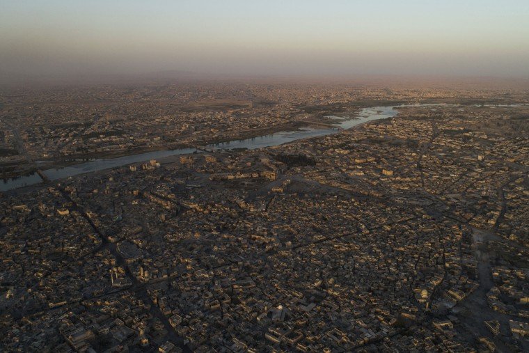 Image: The Tigris river separates the east, top, and west side of Mosul, seen here during fighting on June 29.