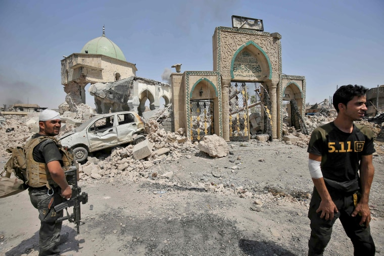 Image: Members of the Iraqi Counter-Terrorism Services stand near the destroyed Al-Nuri Mosque in the Old City of Mosul, as they continue their offensive to retake the city from the Islamic State.