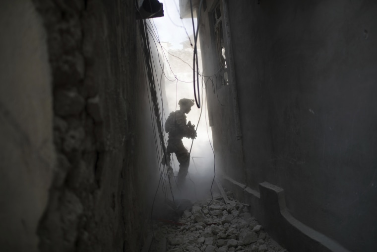 Image: An Iraqi Special Forces soldier exchanges fire with Islamic State militants in the ongoing battle for the Old City of Mosul, Iraq on June 30, 2017.