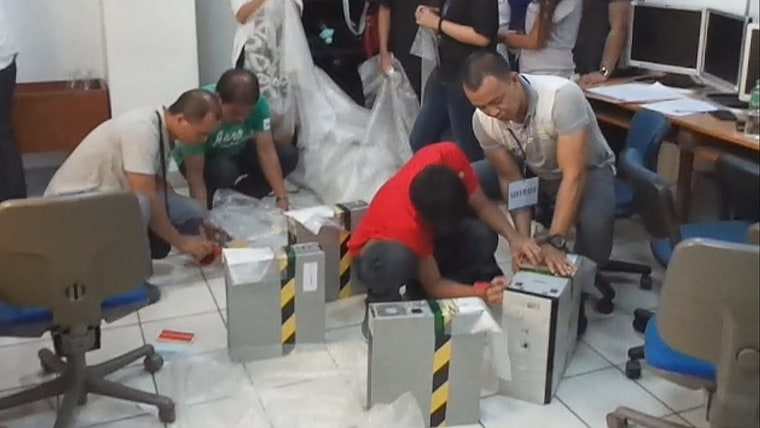 Image: A court-ordered raid on the Philippines headquarters of Avion