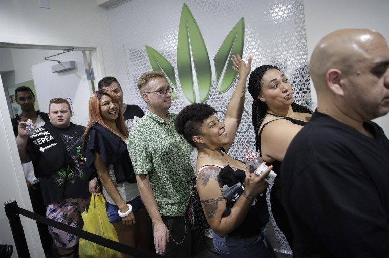 People wait in line at the Essence cannabis dispensary, Saturday, July 1, 2017, in Las Vegas. Nevada dispensaries were legally allowed to sell recreational marijuana starting at 12:01 a.m. Saturday.