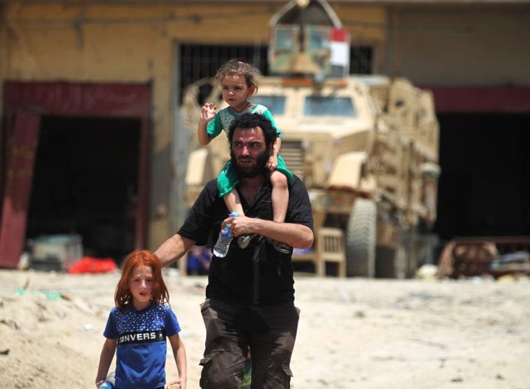 Image: Civilians flee the Old City