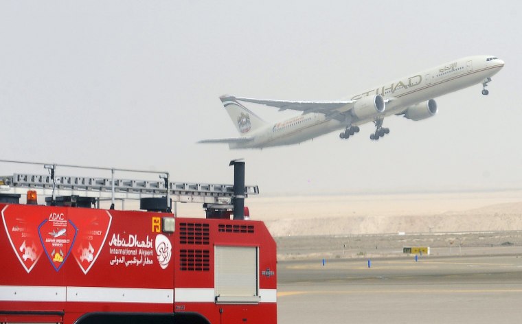Image: An Etihad Airways aircraft takes off from Abu Dhabi International Airport