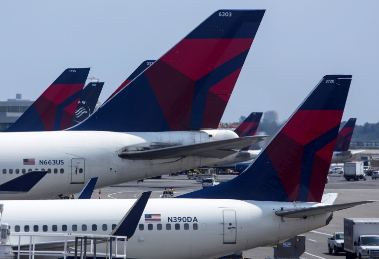 Image: Delta Airlines planes sit at a terminal.