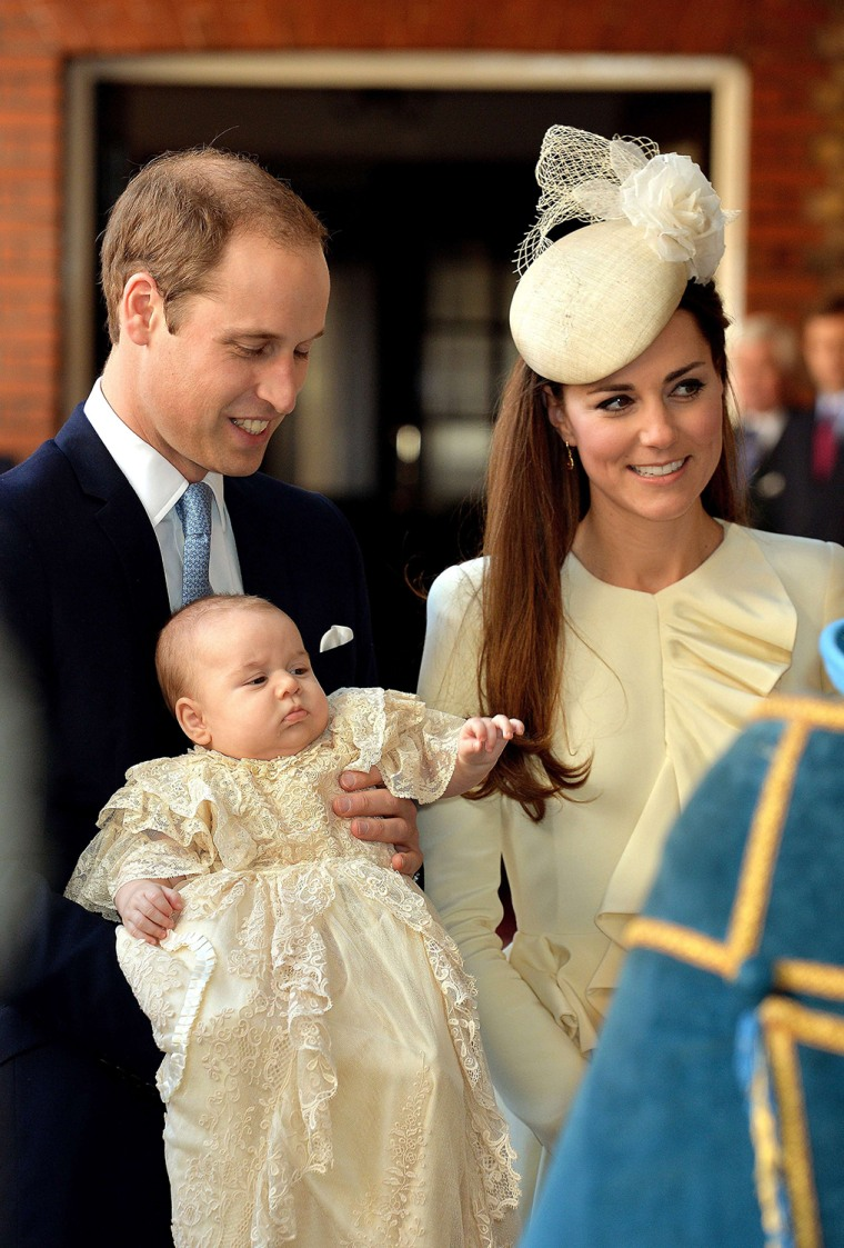 Prince William, Duke of Cambridge and his wife Catherine, Duchess of Cambridge, arrive with Prince George of Cambridge at Chapel Royal in St. James's Palace in London on Oct. 23, 2013, ahead of the christening of the 3-month-old prince.